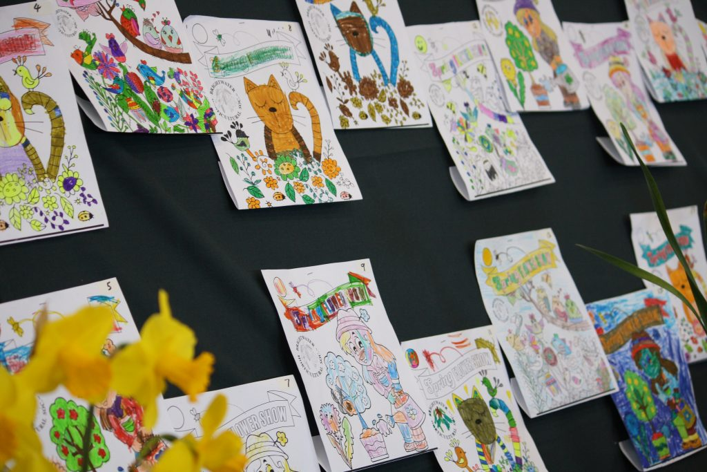 Colouring Competition entries displayed on the wall